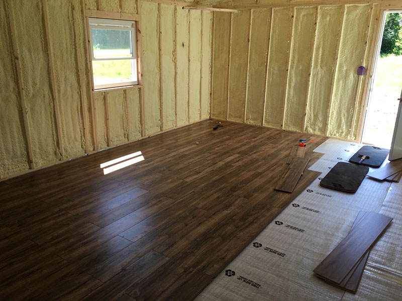 Laying floor in off grid cabin
