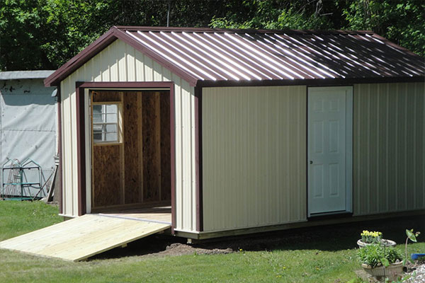 Metal garage for lawn and garden tool shed